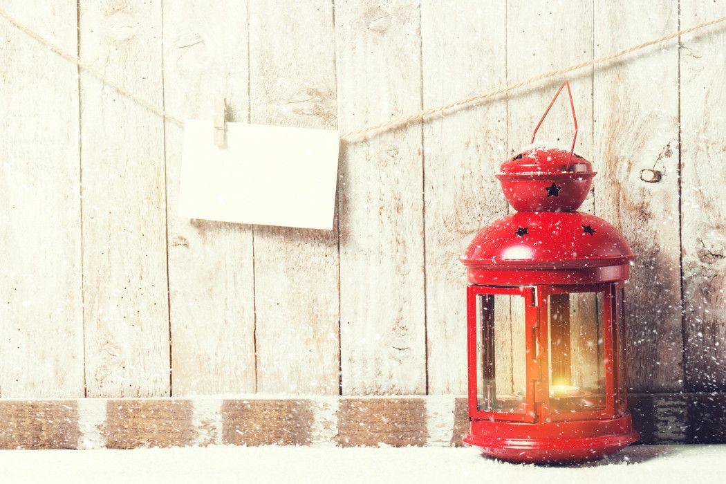 Christmas concept with lantern on a wooden background. Christmas, home or winter concept